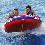 """Airhead Shockwave 2 Brand New Includes One Year Warranty, The Airhead AHSH-2 Shockwave 2 is a 2 person towable that features inflatable stabilizer fins, which help riders stay on the raft and provide a safer riding experience, keeping riders separated"